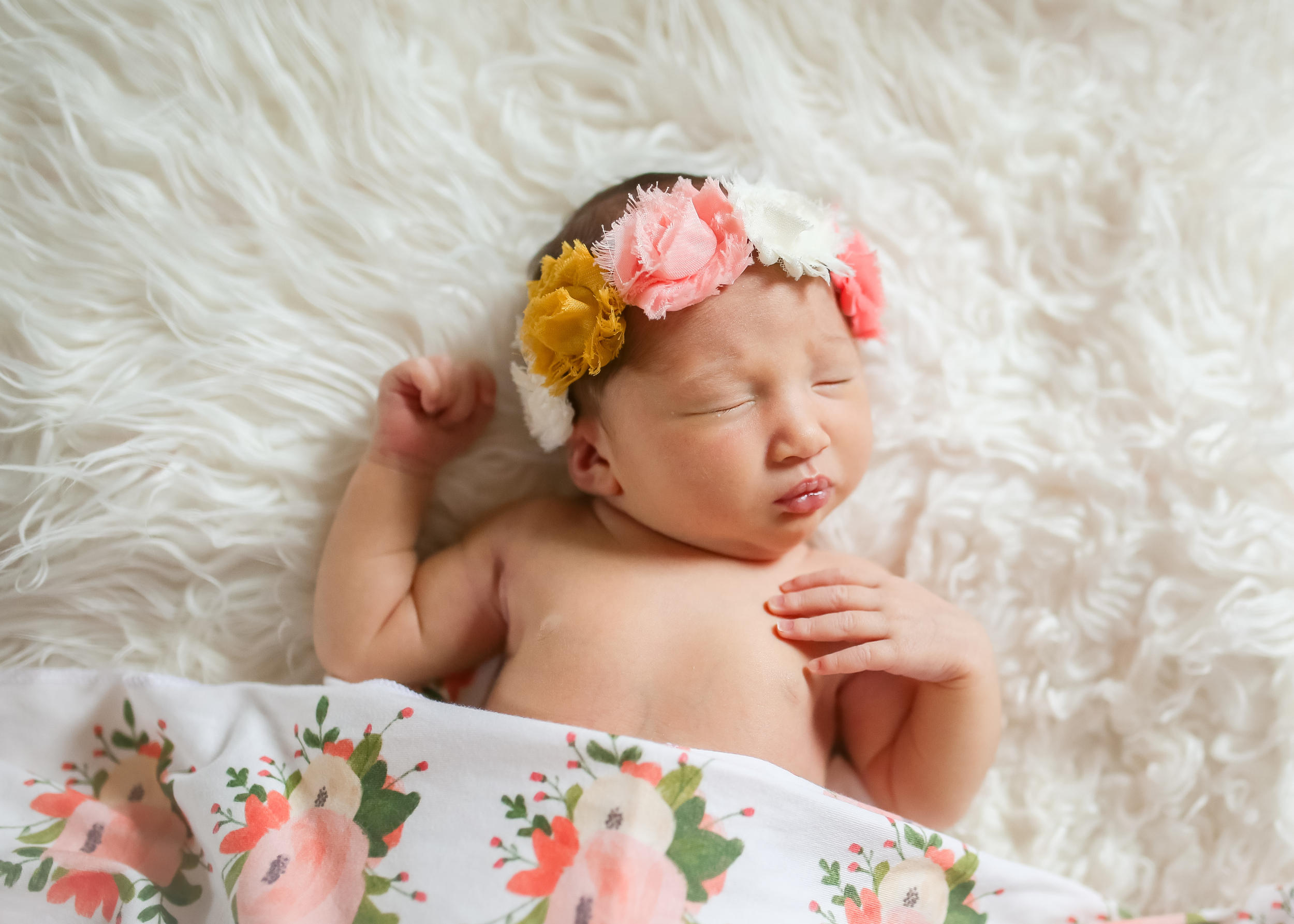 newborn girl with floral details