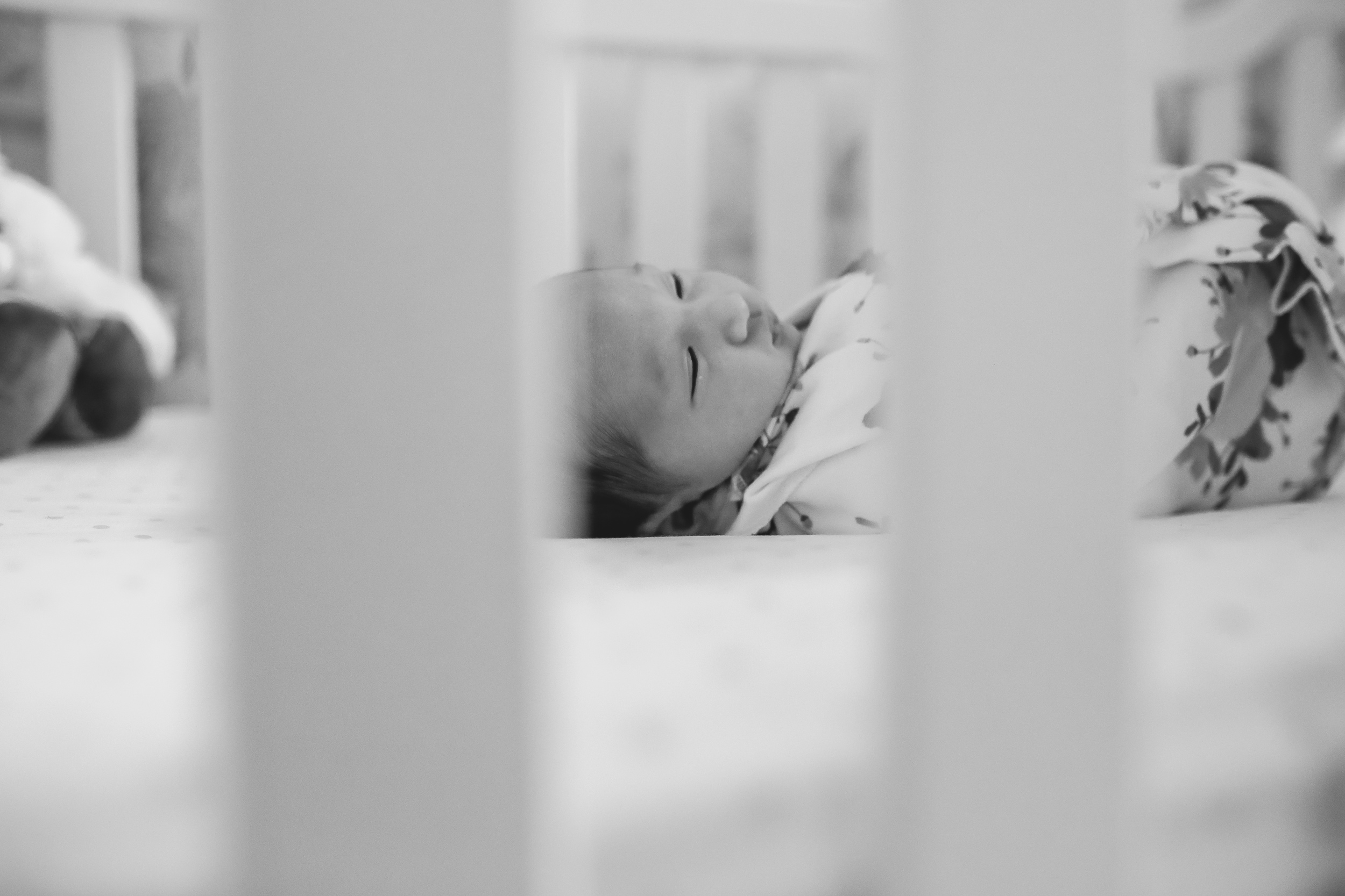 newborn baby in crib