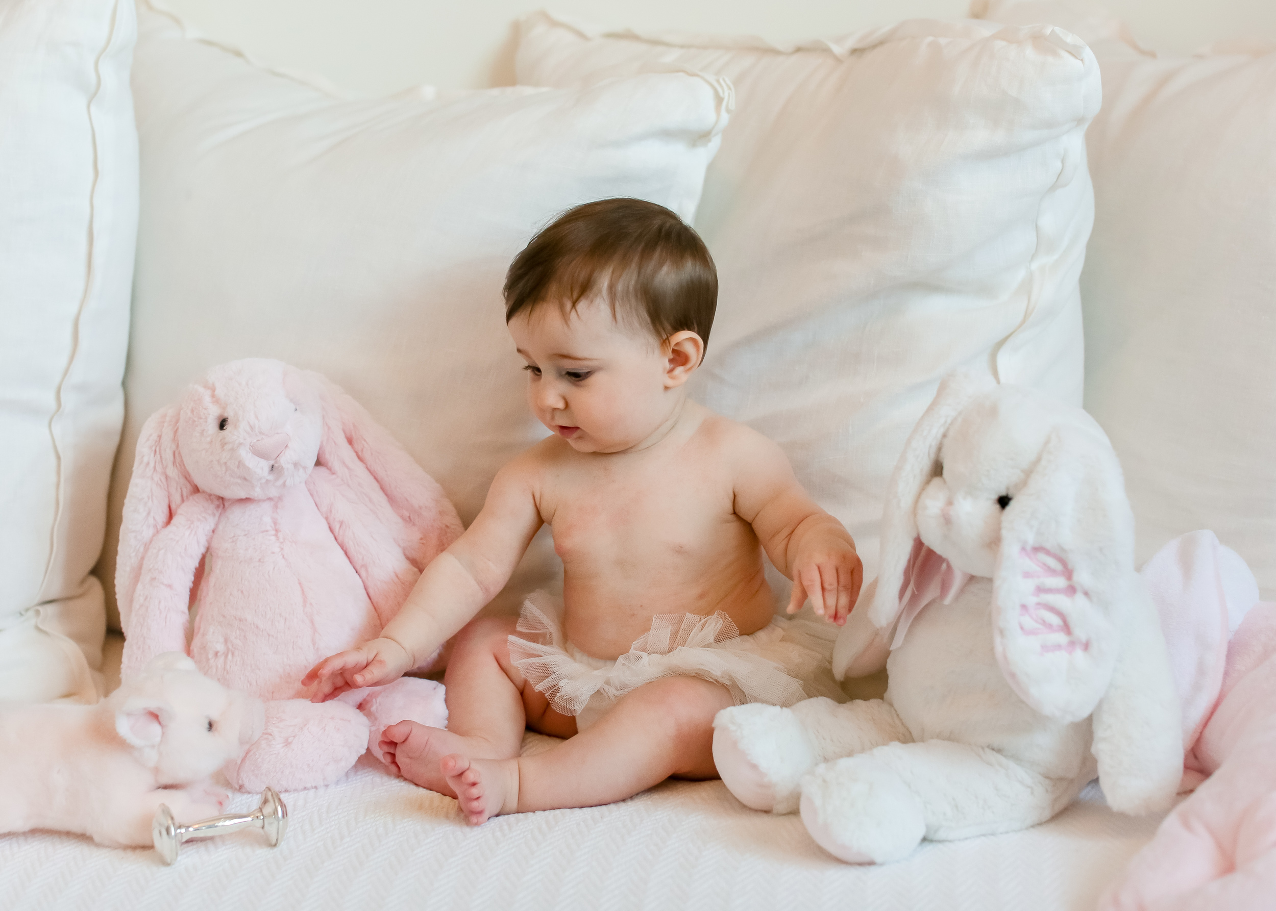 baby girl in pink nursery