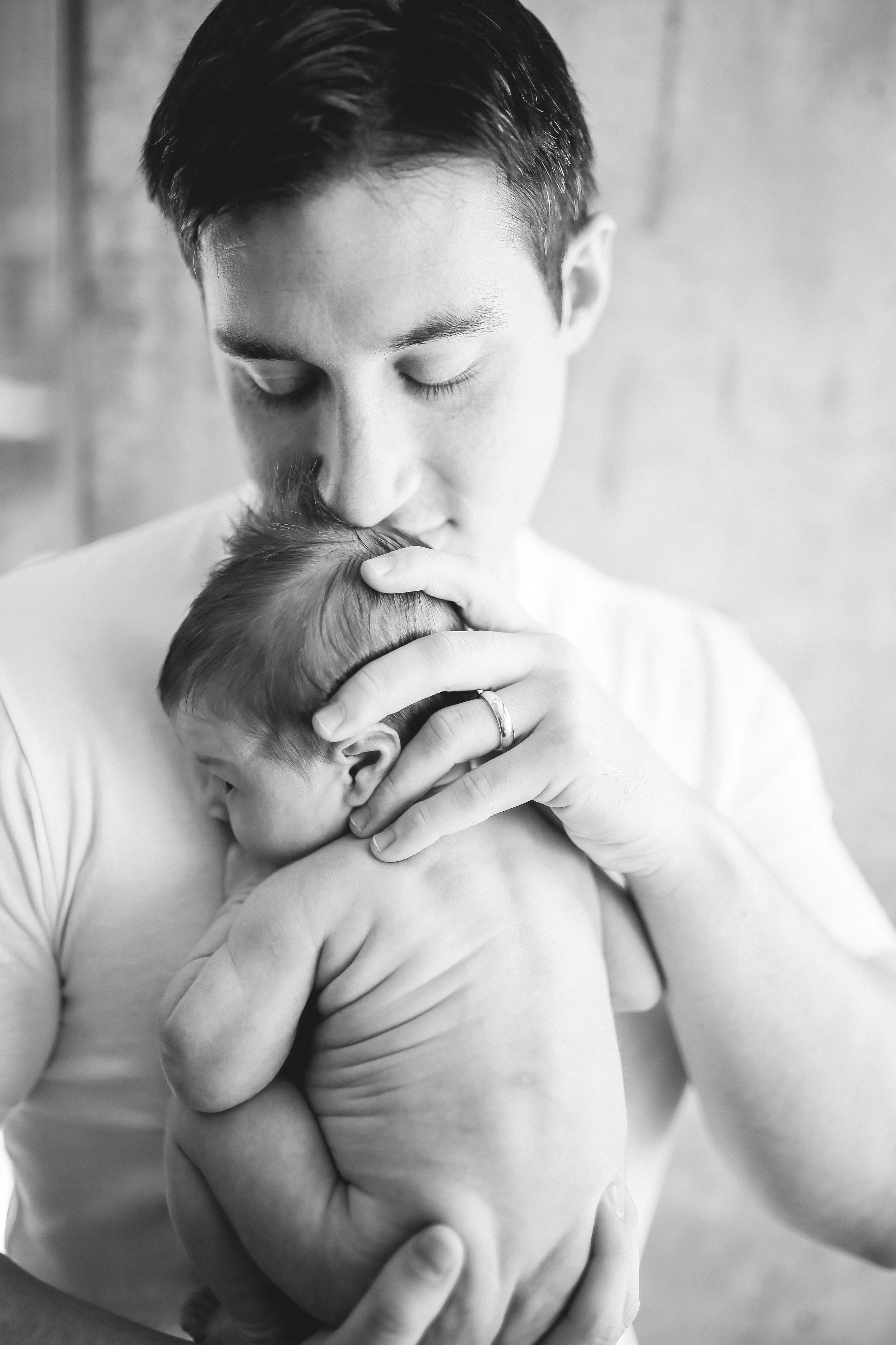 daddy smelling naked newborn baby