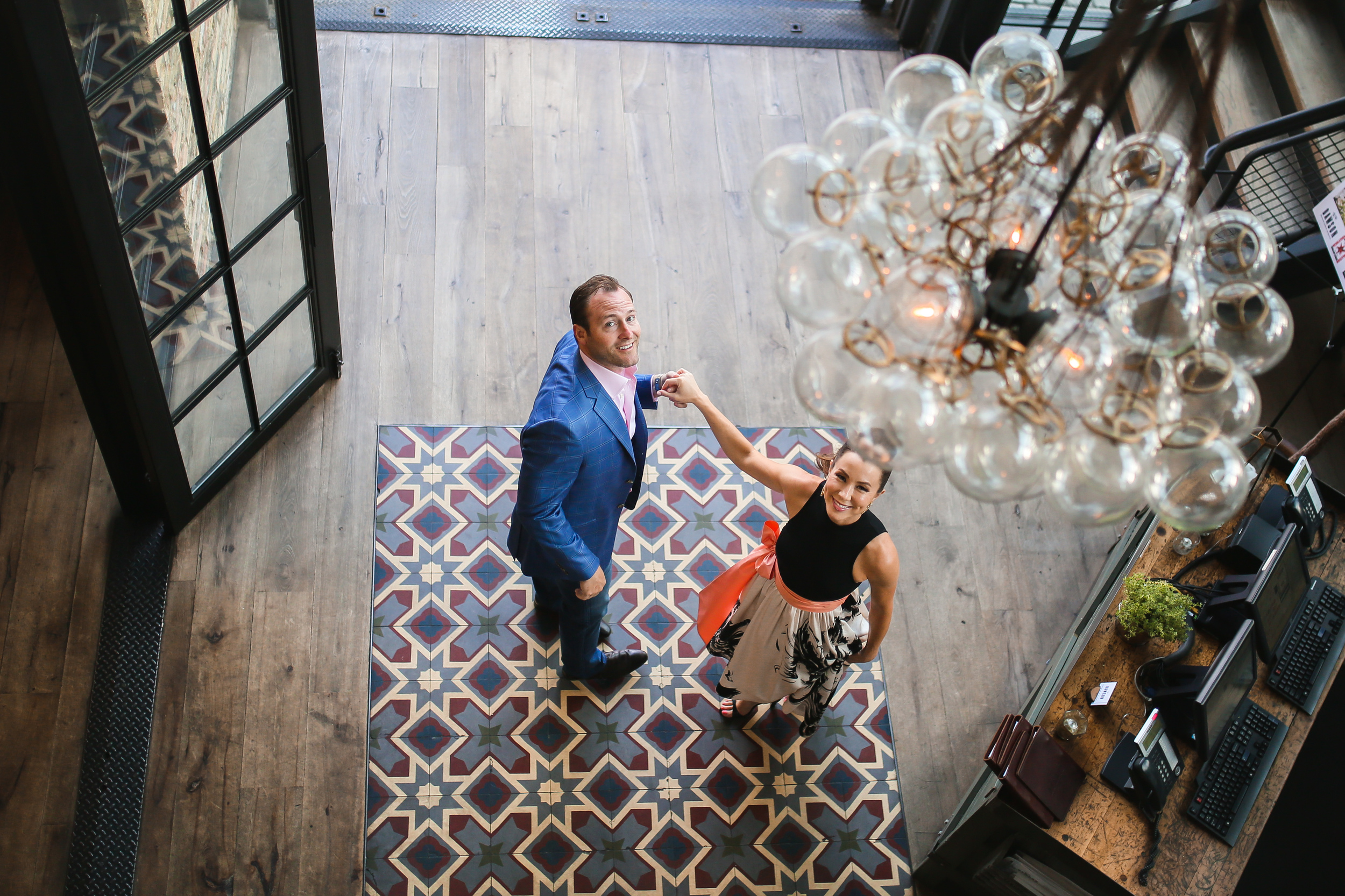 couple in middle of tiled foyer