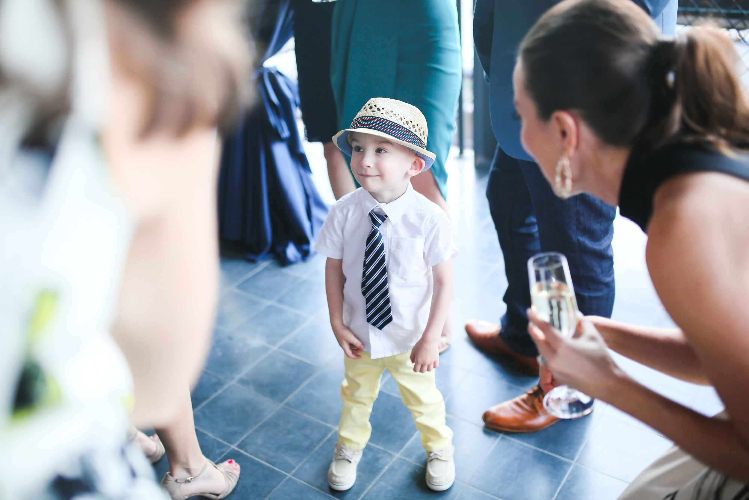 adorable little boy surrounded by ladies
