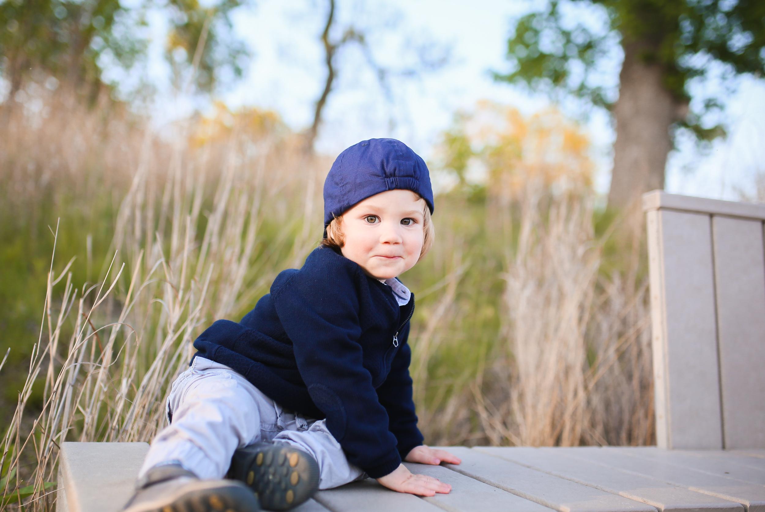 toddler boy with backwards ball cap