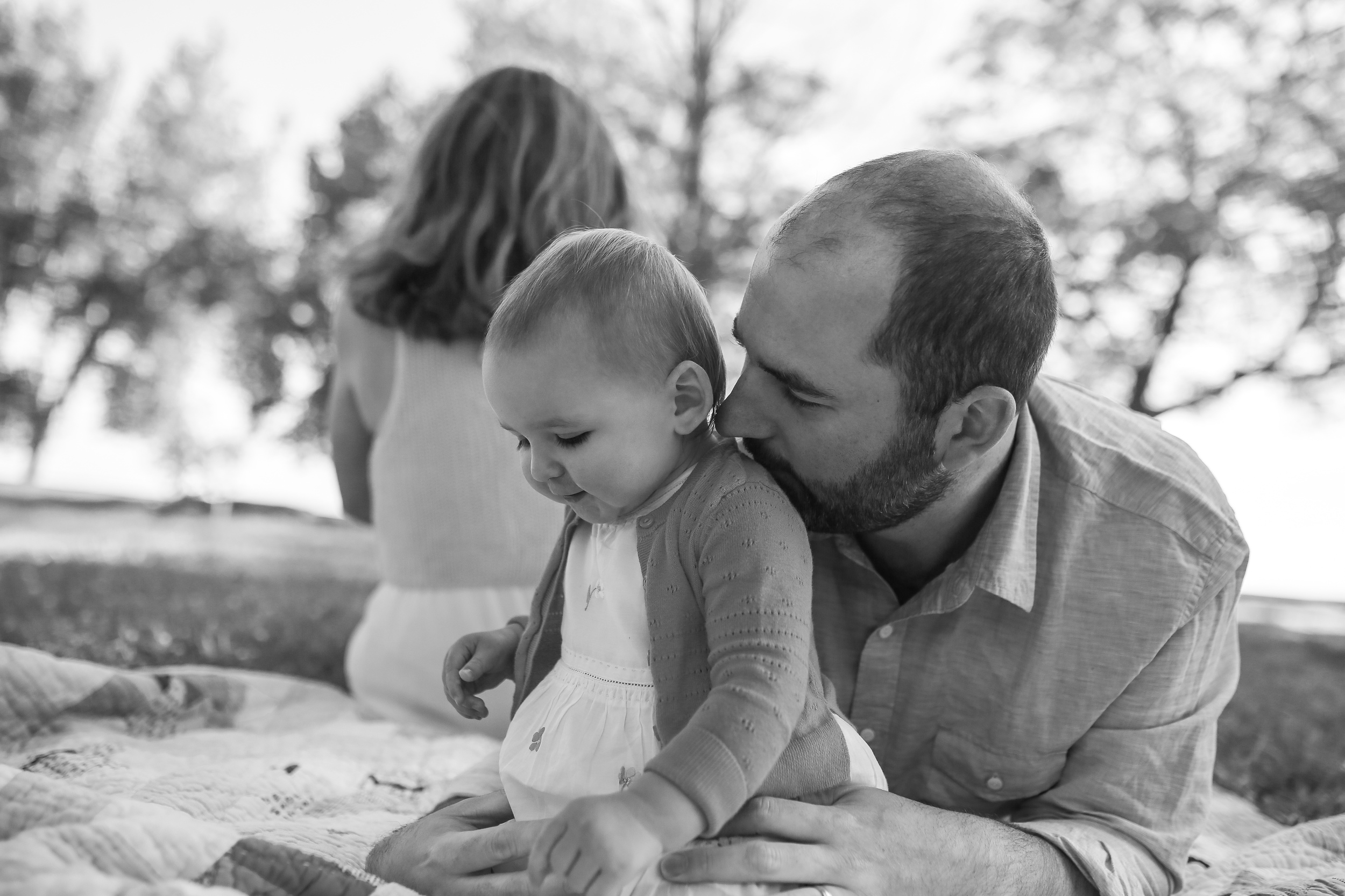 little girl holding flower with daddy