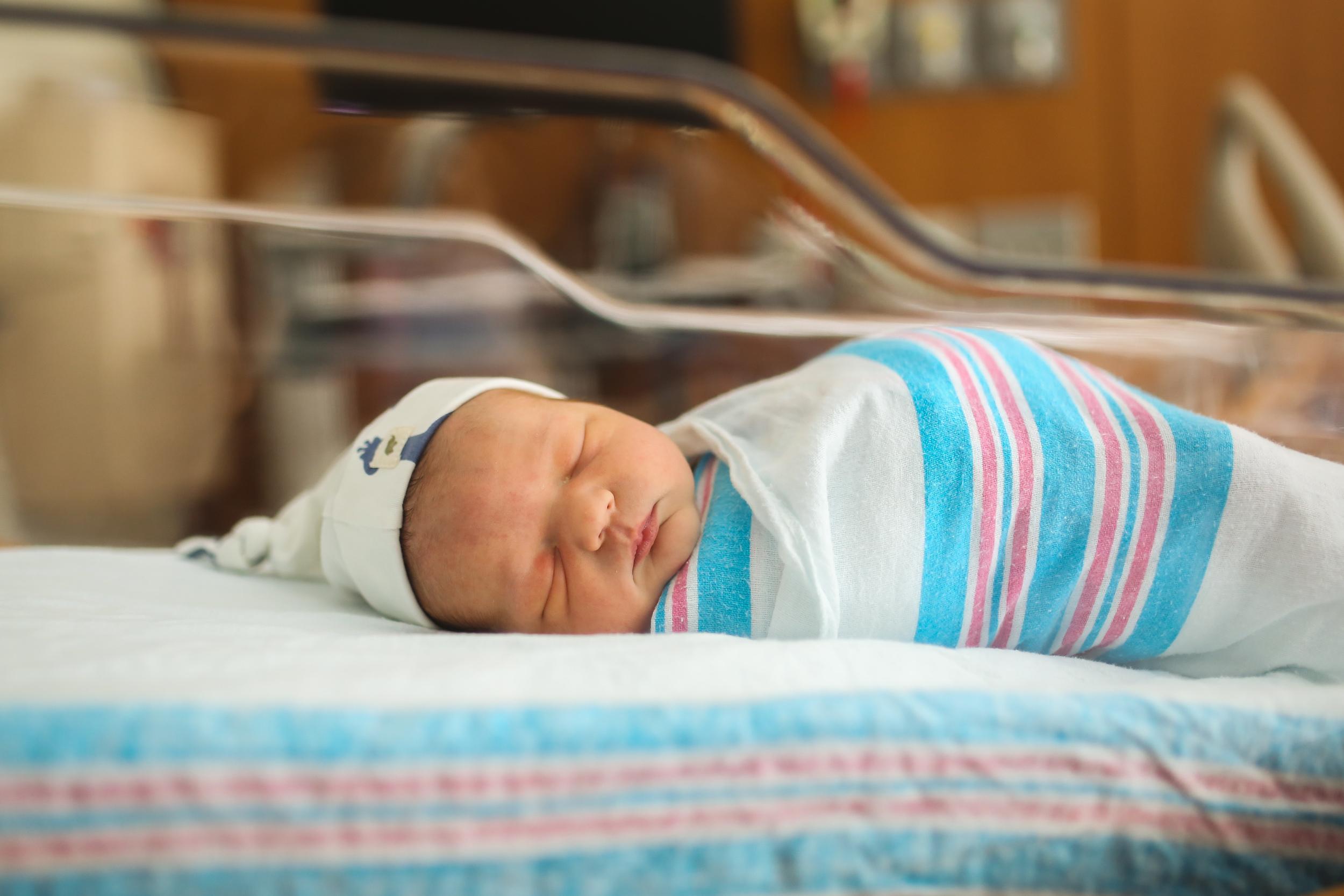 chicago newborn baby swaddled in hospital blanket