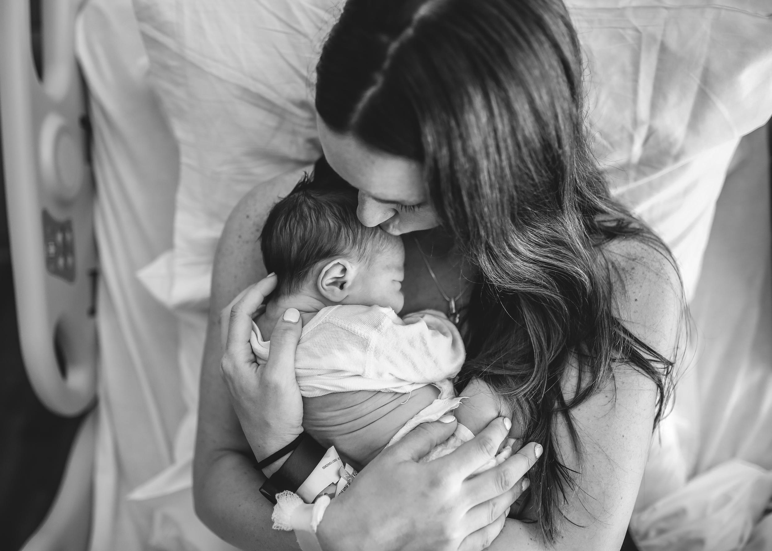 newborn baby and mama kiss