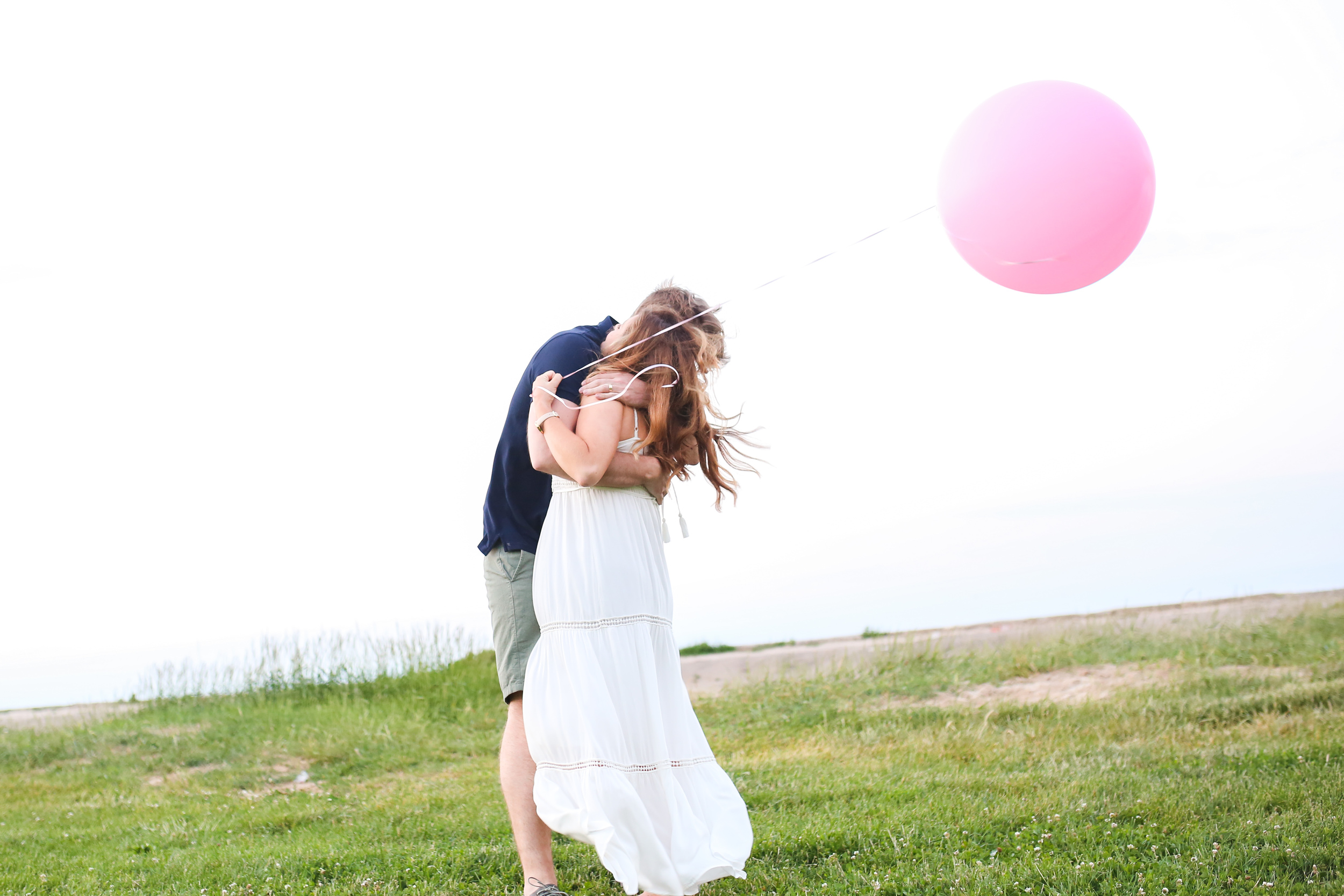 hugging wife with balloon