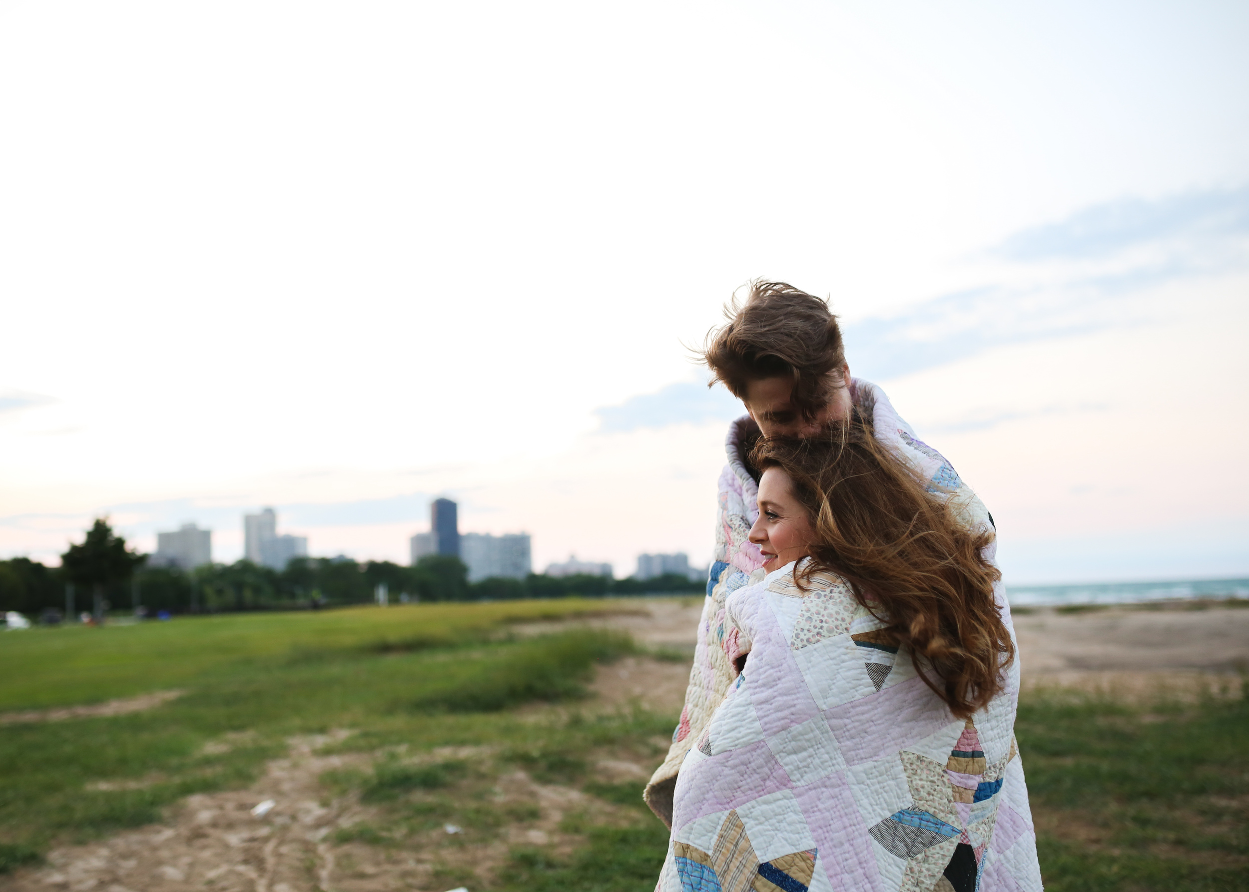 chicago couple in vintage pink quilt