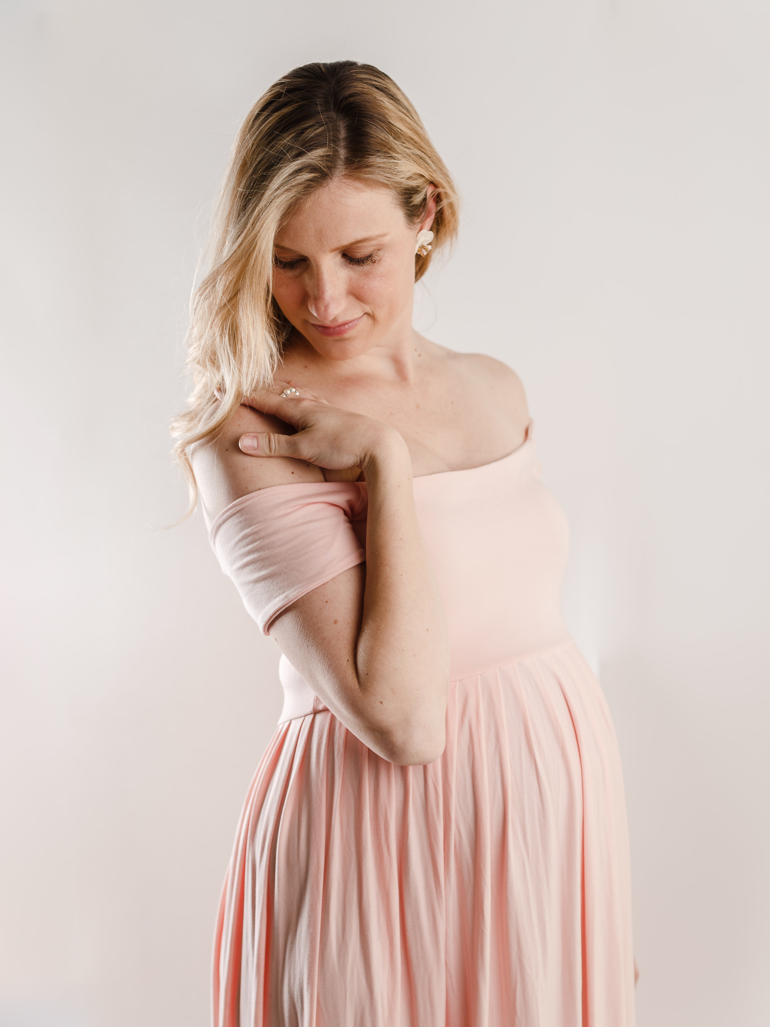 "PINK KELLY MAXI GOWN   This stunning maxi gown is a fabulous option with the off-the-shoulder short sleeve. An empire waist lends to plenty of room with your baby bump in this comfortable pink knit fabric. Straight top across the bust.   Skirt Length | Approx. 58"" from under the bust to the floor  Skirt Material 