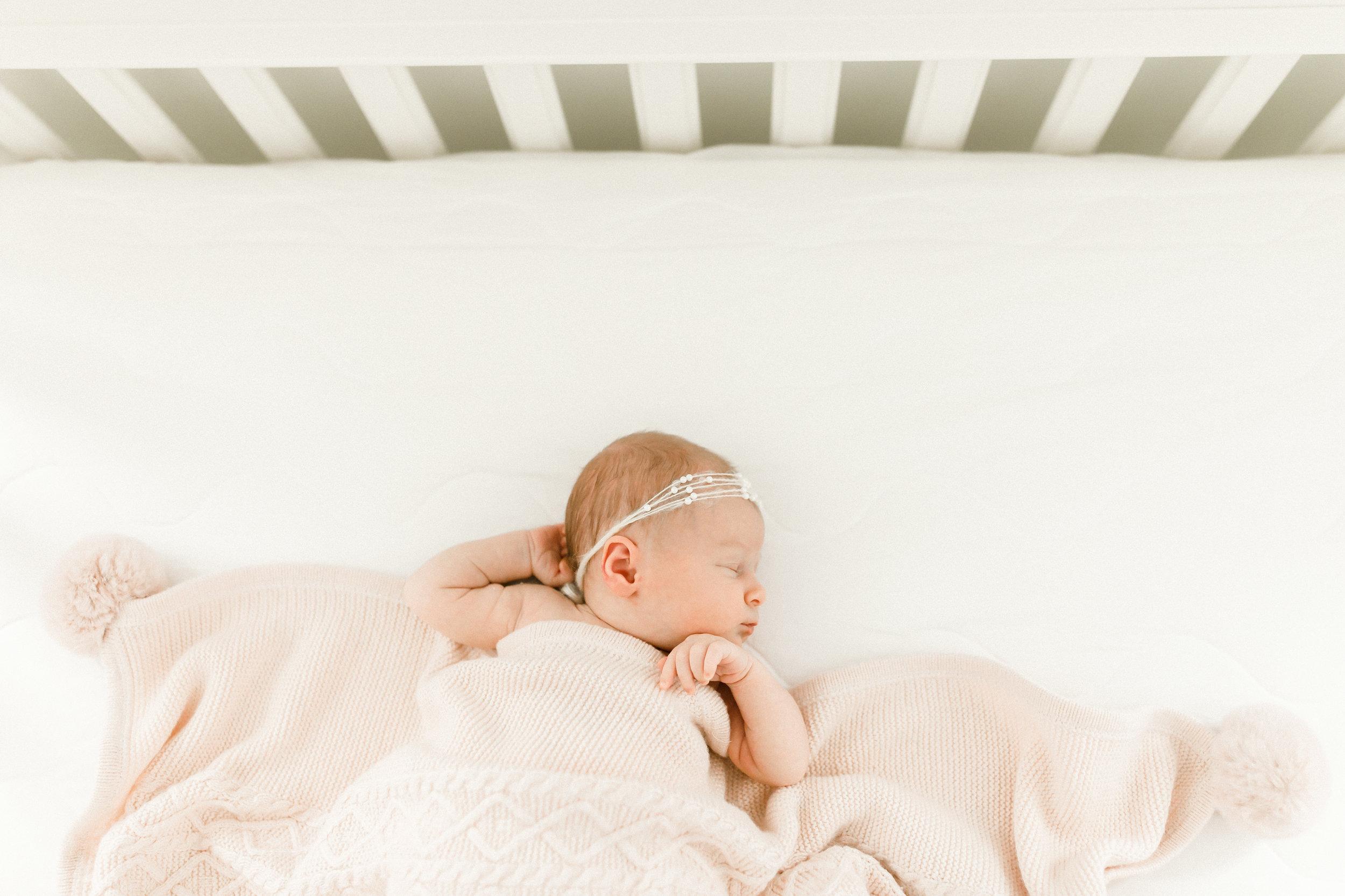 chicago newborn lifestyle photographer jenny grimm photography baby girl white crib