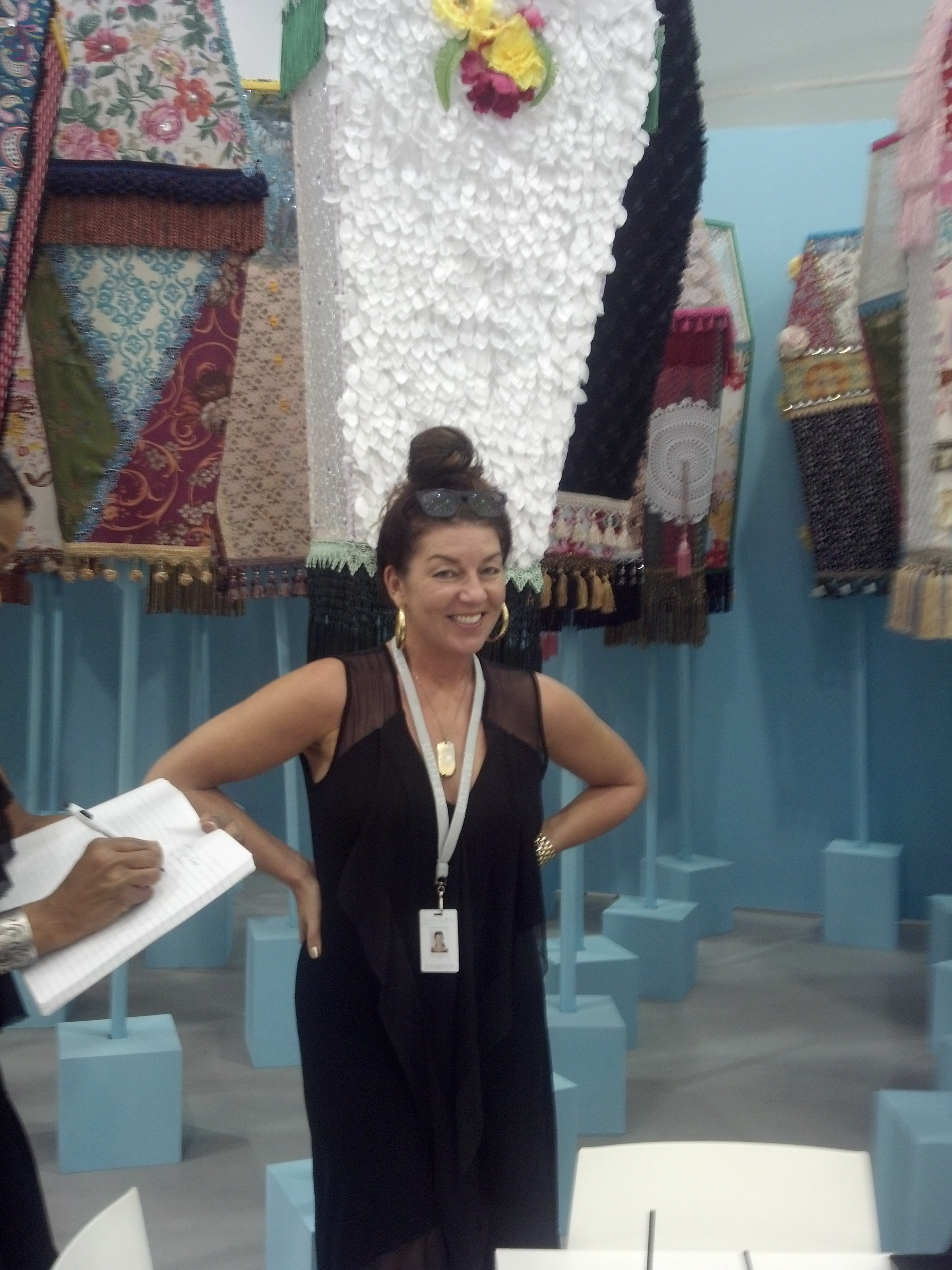 Monique Meloche in her booth at  Untitled  with an installation by Ebony G. Patterson