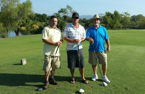 Ken Palmerand Curtis Eichorst of Delco Salespictured with Ryan Phipps of NP Mechanical at the Flamingos Golf Course in Puerto Vallarta.