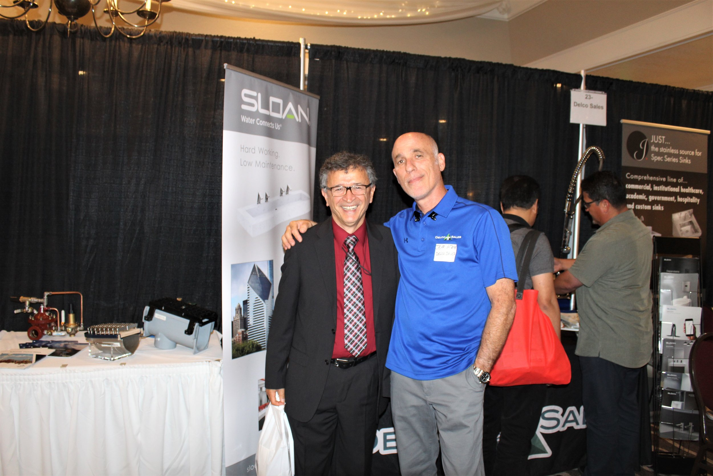 Delco Sales Specification Team Member Jeff Atlas takes a pic with longtime friend Dr. Saum K. Nour