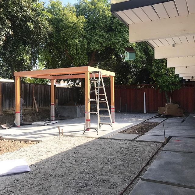 Construction in progress :: pergola with heater underway, poured and sand-blasted concrete pavers and patio complete.  #variegatedgreenlandscape #eichler #modernlandscape #modernpergola #landscapedesign #gardendesign #californiamodern #backyarddesign