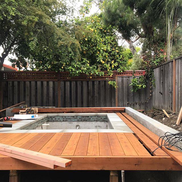 Decking around custom spa going in...new fencing, lighting and plants next! #variegatedgreenlandscape #concrete #customspa #deck #landscapedesign #gardendesign #outdoorliving #modernlandscape #californiamodern