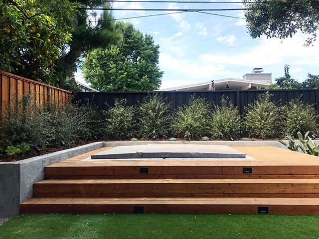 Step on up :: getting close on finishing up my client's backyard remodel including this custom hot tub partially in-ground with a raised decking surround to add levels and differentiate it from the adjacent functional spaces.  #variegatedgreenlandscape #customspa #decking #outdoorliving #landscapedesign #gardendesign #dwell #californiamodern #eichler #eichlerlandscape #modernlandscape