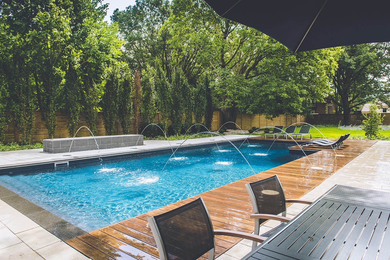Waterfalls & Deck Jets installed by Creative Pools and ...