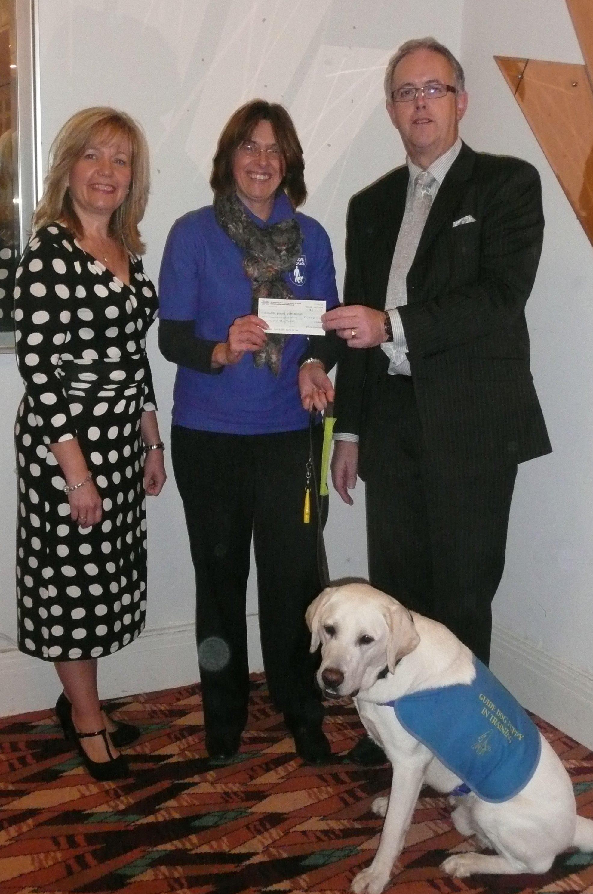 Mark and Tracey Helmore alongside Linda and guide dog puppy Weston
