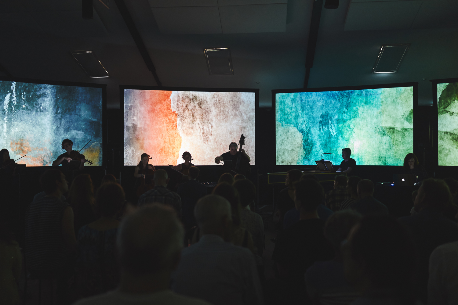 Anno---Performance-with-audience-and-bright-watercolour-screens.jpg