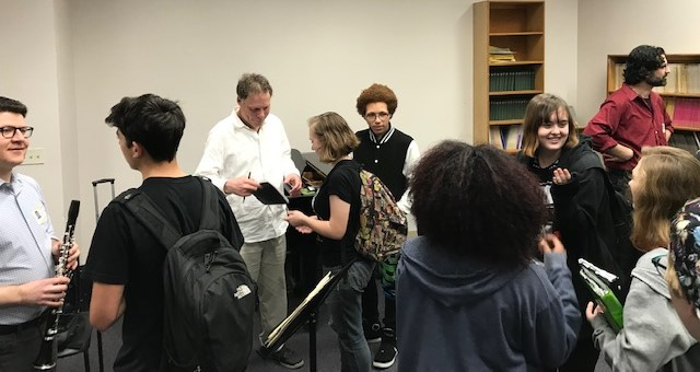 Eau Gallie High School music students speaking with members of the GPF Trio following their outreach event in April 2019.