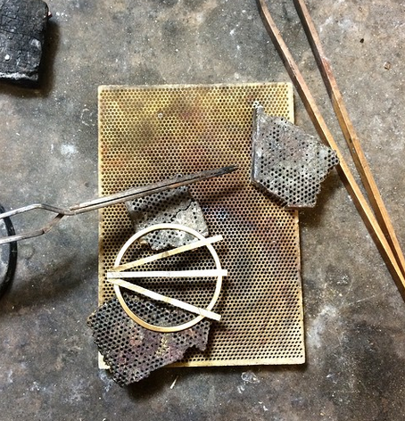 A very fun pair of commissioned earrings in process.