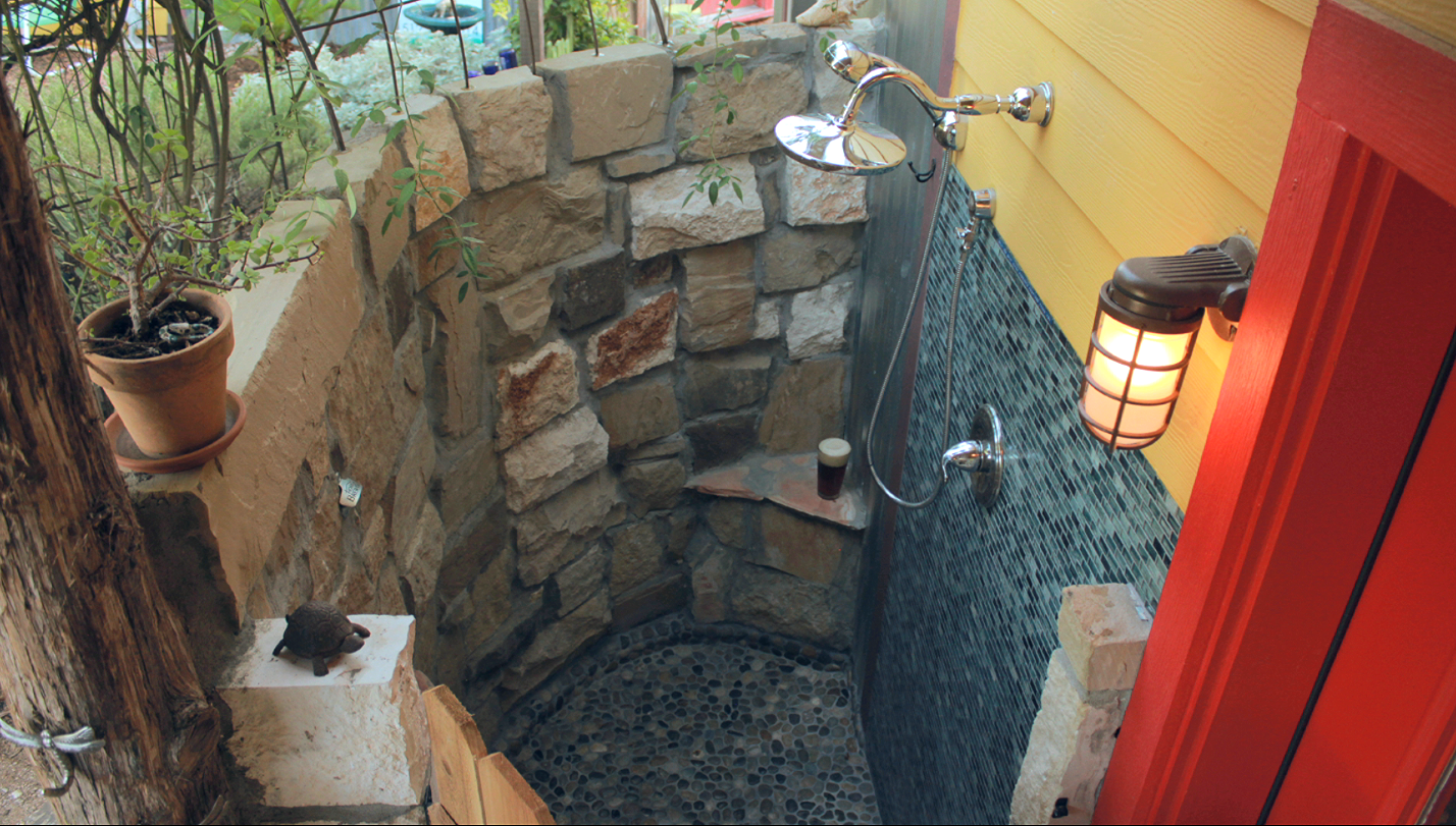 Incredibly romantic and roomy outdoor shower, perfect in ALL weather...warm up or cool down just one step from the front door. Enjoy two showerheads, a tiny bench and place to sit your beer. Please use our fabulous gray-water safe products for hair and body as this shower feeds into our award winning, organic garden!
