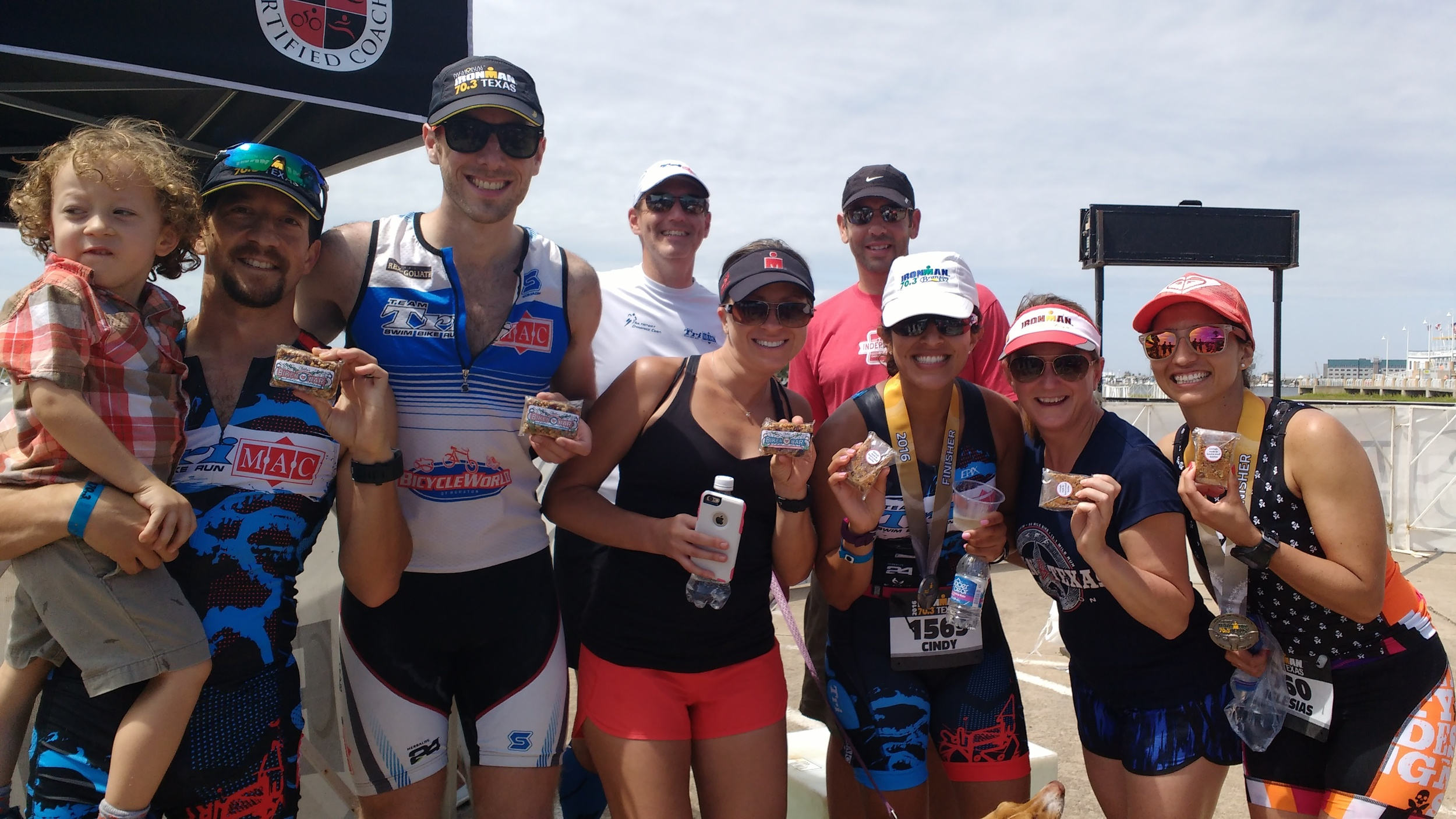 Another awesome photo with a group of Team TriMAC athletes, fresh from the finish line at Ironman 70.3 Texas in Galveston on April 9, 2016.