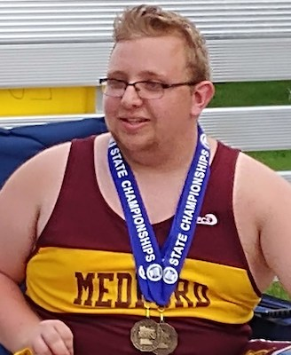 2018-19 MN Track & Field    Discuss Throw Wheelchair    Luke Johnston    Medford    Photo Credit: KRFO Radio