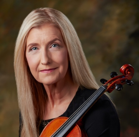 """Gayle McCutchan, Violin - Gayle McCutchan joins the Conservatory as guest violin instructor through Summer 2019. Gayle was raised in Boise, Idaho and began playing the violin at age nine. In her young career, she participated in multiple ensembles, including the Boise State College orchestra, the Treasure Valley Youth Symphony, and both the All-State and All-Northwest orchestras. As a high school sophomore, she was the recipient of the bronze medal in the Treasure Valley violin solo competition, playing Vieuxtemps Concerto No. 4 in D Minor. The following year, she took the gold medal with Lalo's Symphonie Espagnole. After high school, Gayle pursued playing opportunities with groups in many locations, often in a leadership role as a principal player. Over the years, she has played with a variety of orchestras, including the Grass Valley Symphony Orchestra, Yuba-Sutter Symphony Orchestra, Saddleback Symphony Orchestra, Palomar Symphony Orchestra, Poway Symphony Orchestra, Poway Symphonette (where she is currently Principal Second), Cardinal Chamber Ensemble at North Idaho College, and the Pend Oreille Orchestra. Gayle's favorite orchestral piece is Scheherazade by Rimsky-Korsakov, although she has lately become enamored with modern composer Alec Roth's cantata entitled, """"A Time to Dance."""""""
