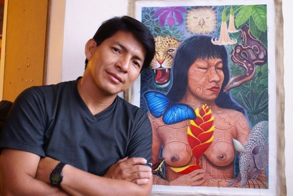 Moises Llerena next to his work