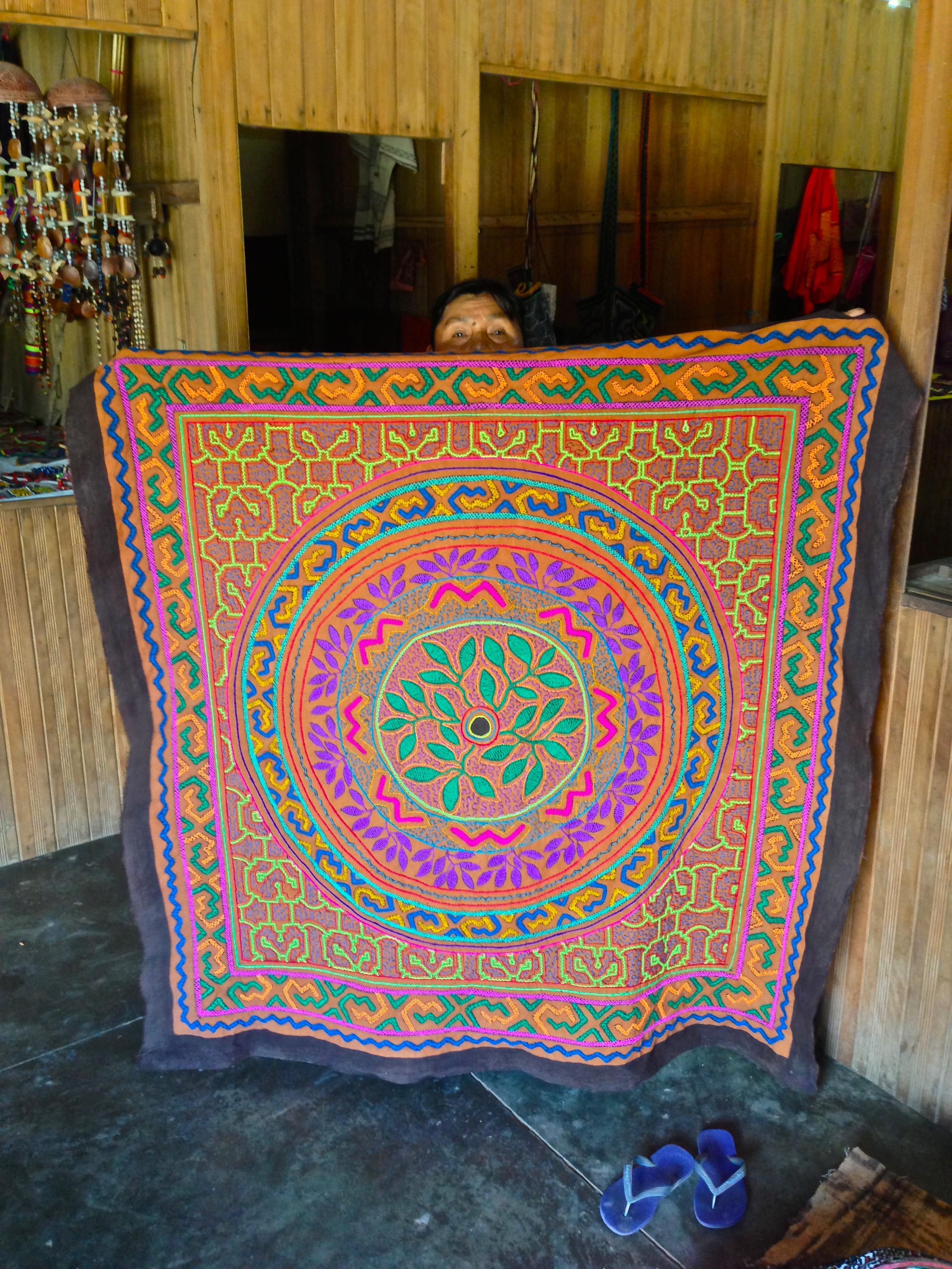 Shipibo artist displaying her work in Pucallpa, Peru