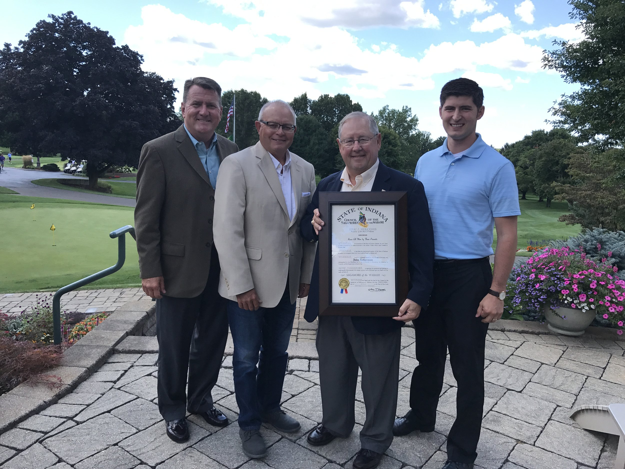 John Letherman receives The Sagamore of the Wabash Award. Pictured, from the left: Mark Dobson, State Representative Doug Miller, John Letherman and State Representative Timothy Wesco.