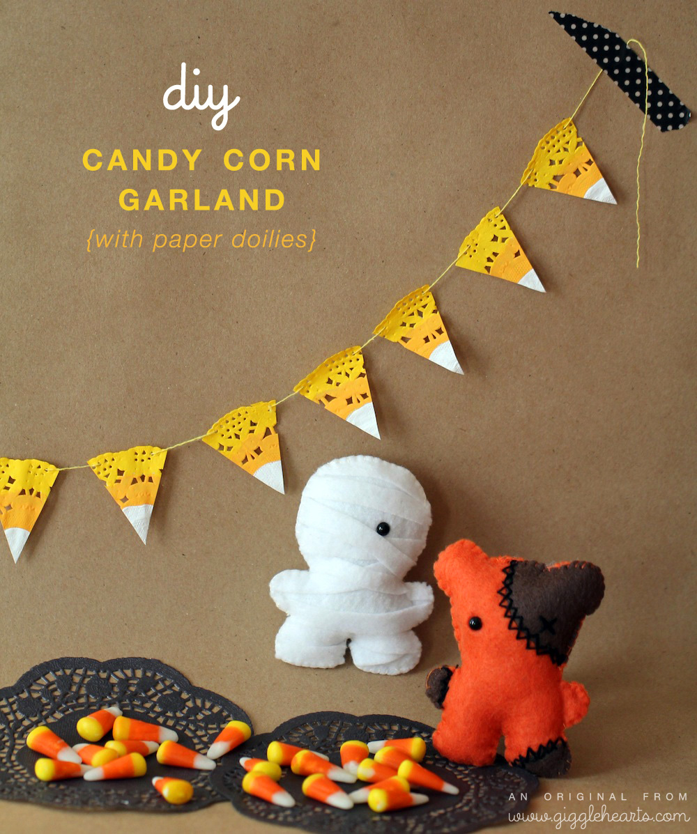DIY Candy Corn Garland : created with paper doilies and featuring Squatles {sweet little felt creatures} / from www.GiggleHearts.com