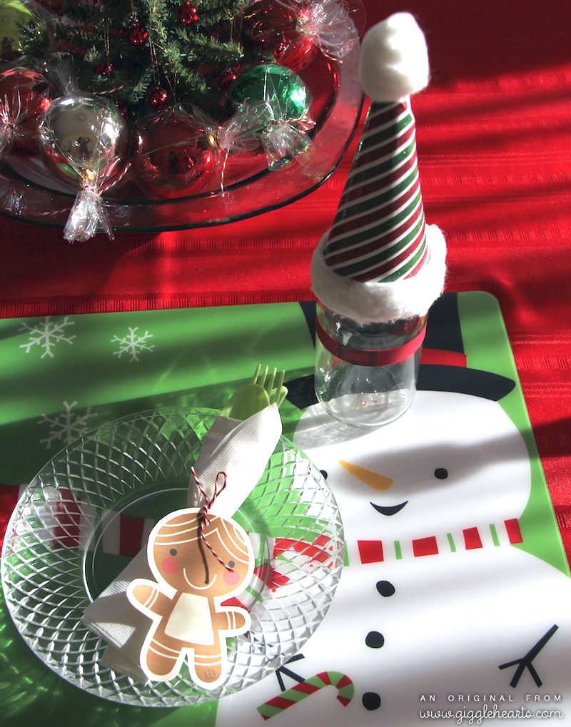 Cute Placesetting for Christmas with a Santa Hat Topping a Milk Glass with a Paper Belt / as seen on www.GiggleHearts.com