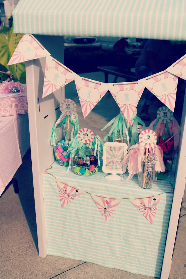 A vintage yet modern 3rd birthday party - IKEA grocery stand converted to be a ticket booth / created by EAE Personalized Creations / as seen on www.GiggleHearts.com