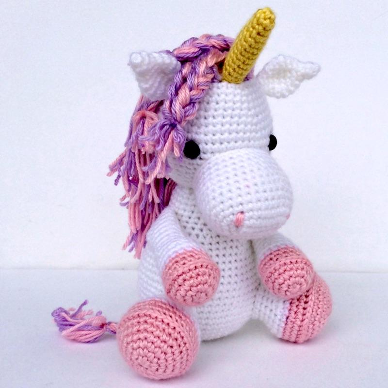 A sweet little handmade stuffed unicorn - a crocheted magical horse