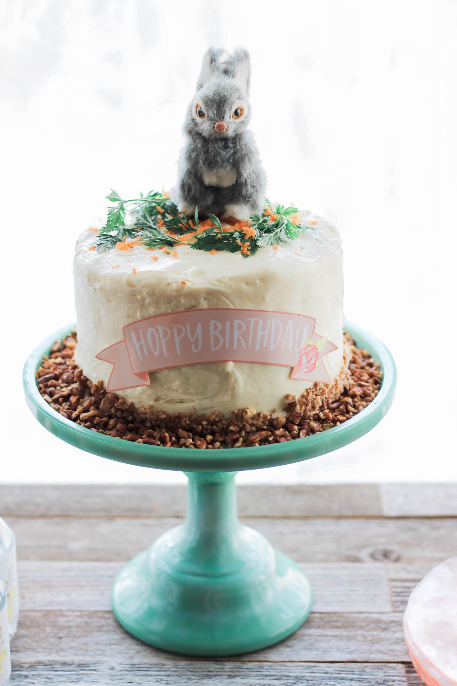 Bunny Topped Cake with garnish of grated carrots and parsley sprigs — from a Some Bunny's Spring Birthday Party . . . click to see more on www.GiggleHearts.com