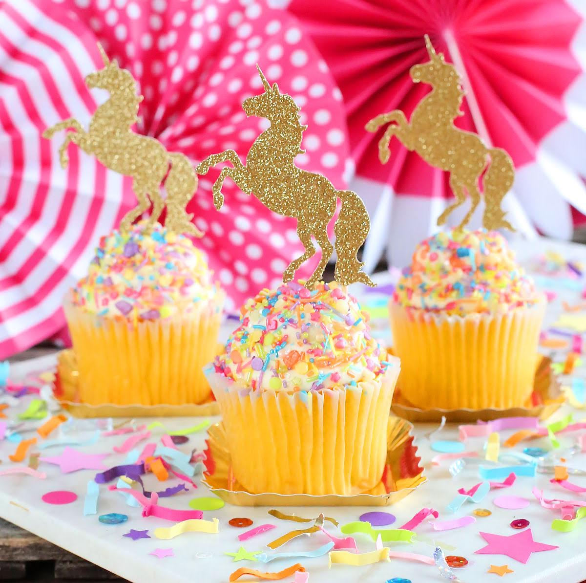 Colorful Unicorn Must-Have Party Items for a Perfectly Styled Unicorn Theme Dessert Table - Unicorn Cupcake Toppers, Sprinkles and Festive Fetti Confetti - from The Bakers Party Shop - see more on www.GiggleHearts.com