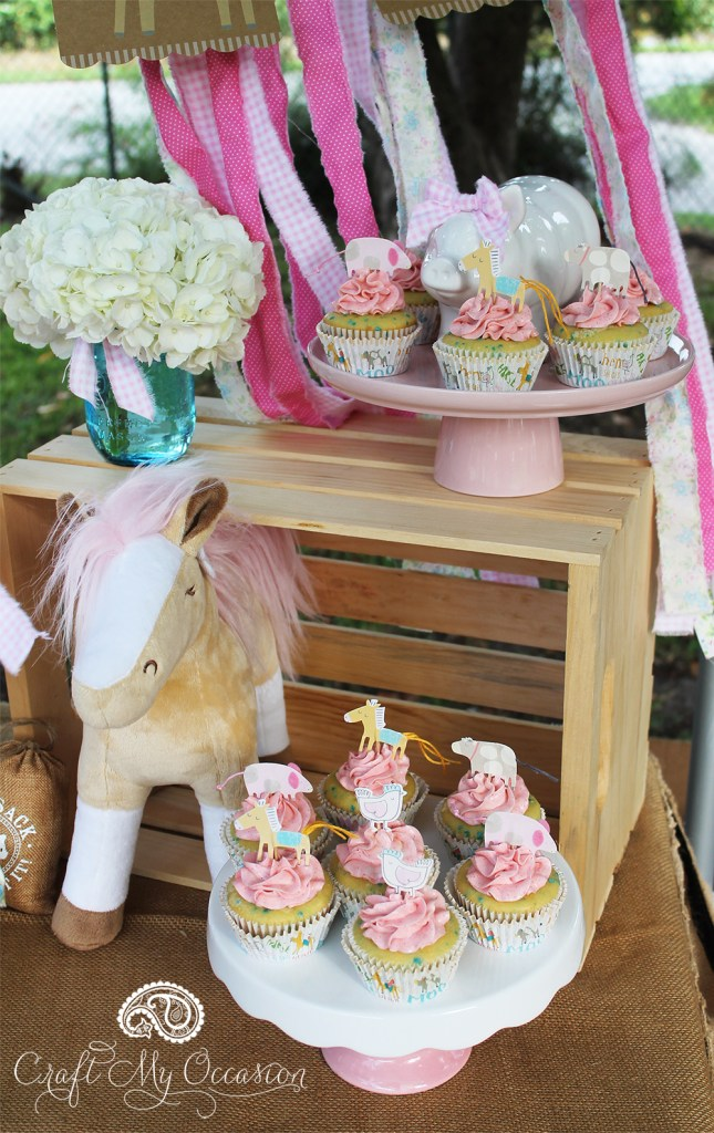 Cute farm themed cupcake toppers with a stuffed horse added as decor from the Pink Pony Birthday Party from Lynnette of Craft My Occasion - as seen in the Party Inspiration Gallery on www.GiggleHearts.com