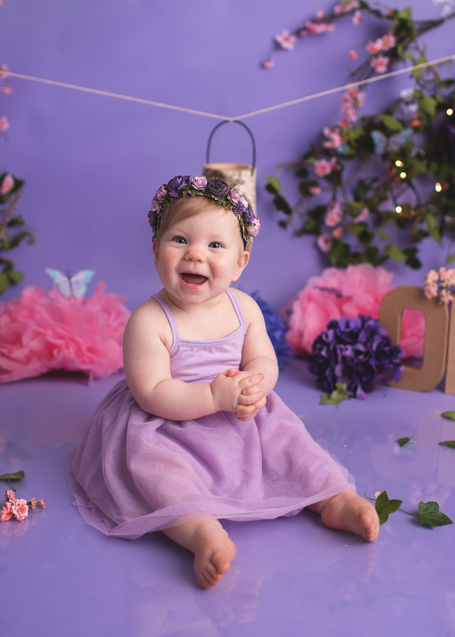 The sweetest purple and pink first birthday photo shoot - a fairy themed smash the cake photo session with Elizabeth Frederick Photography in Connecticut / as seen on www.GiggleHearts.com