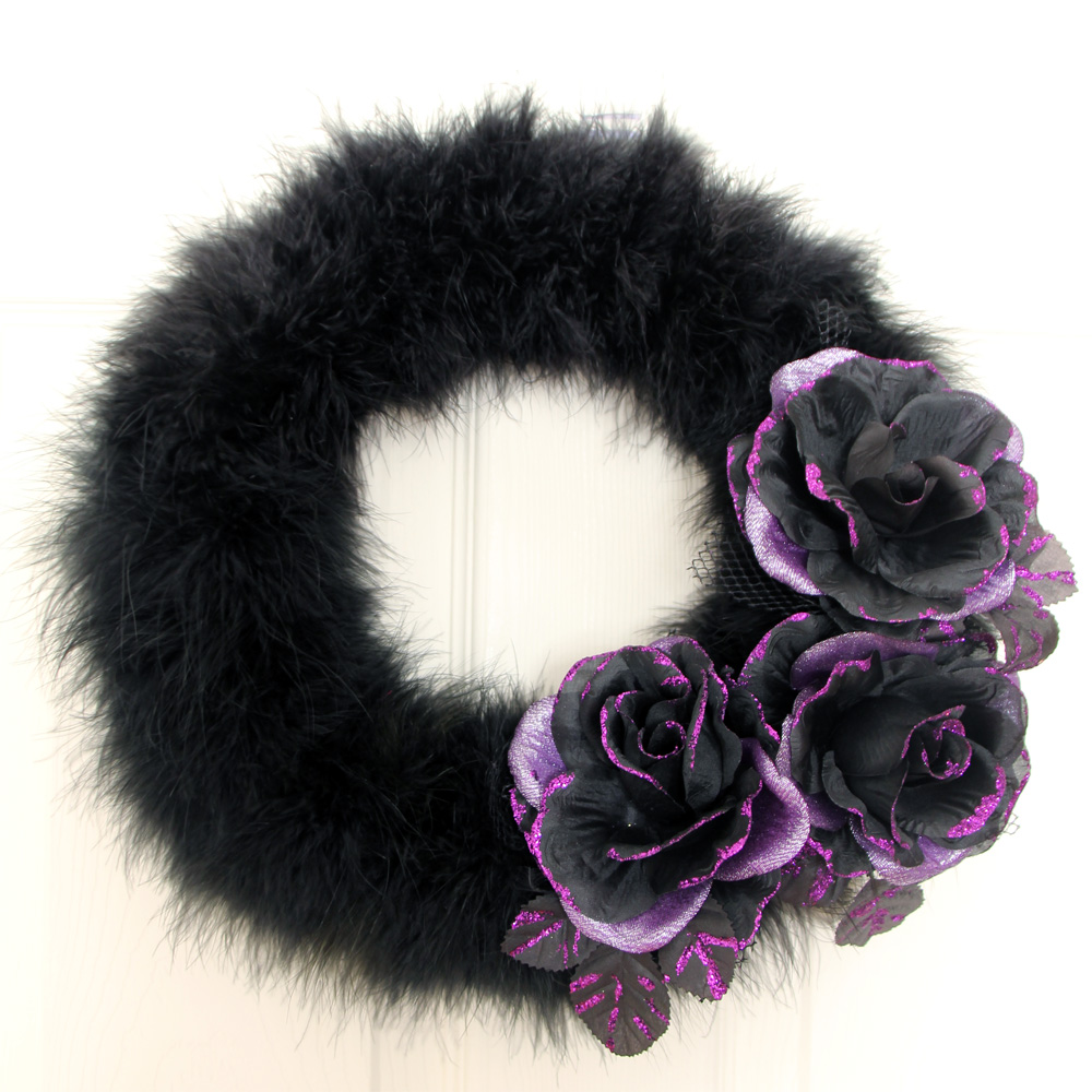 Kids will love making this feather boa Halloween wreath with fabric flowers / click for the DIY Halloween Feather Wreath and see how you can use the flowers after the holiday / as seen on Giggle Hearts www.gigglehearts.com #fallcraftsforkids #fallcraft #halloweencraftsforkids #halloweencrafts #halloweenwreath