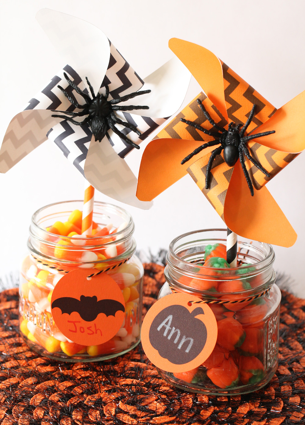 Halloween Pinwheels complete with spiders / these printable pinwheels are the perfect party decoration for candy jars and more. Add a spider for a little extra scare / click to see the DIY and download links for the pinwheels on Giggle Hearts www.gigglehearts.com #fallcraftsforkids #fallcraft #halloweencraftsforkids #halloweencrafts #pinwheelsparty
