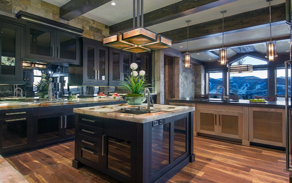 This kitchen is all about lines and angles. Designed by AP Resort Concepts, this design seamlessly incorporates a chandelier and pendant from out Contemporary Collection for ample lighting and efficiency.