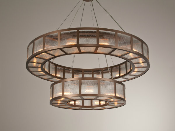 The 'donut' - a sister form to the drum shade - offers a surprising aesthetic when doubled up. Suspending one transparent shade beneath another creates the look of a chandelier while offering the soft, weightless light of a drum fixture.
