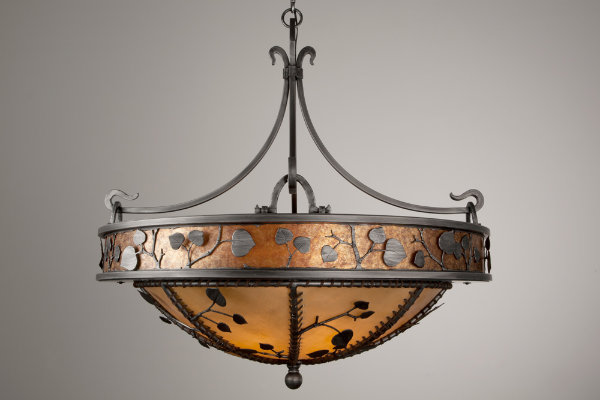 This chandelier-style dome light features a rawhide dome diffuser and a ring of mica banding to showcase its hand-crafted organic leaf motif.