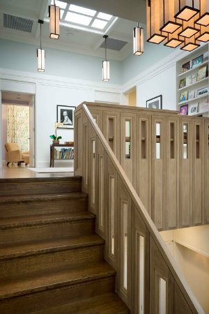 Whether spaced out or clustered together, these rectangular pendants by Hammerton add style and function to this open stairway landing.