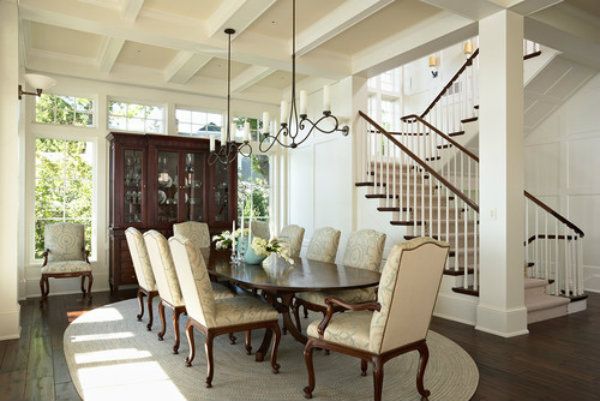 The metalwork on these elegantly crafted Seriph chandeliers instantly transforms this traditional dining room into a transitional work of art.