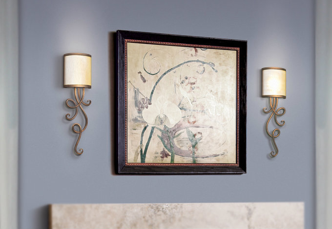 Seriph sconces can complement artwork, but they can also stand alone as a subtle work of functional art for empty wall space.
