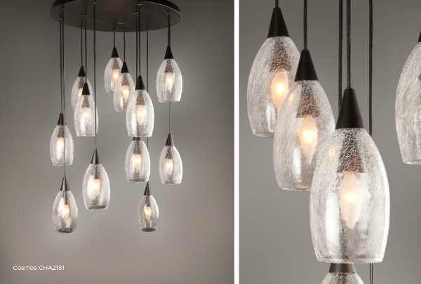 Cosmos pendant chandelier with clear crackle blown glass and a statuary bronze finish.