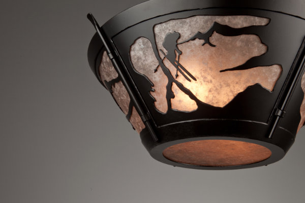 A detailed look at our skier motif in a semi-flush ceiling light.